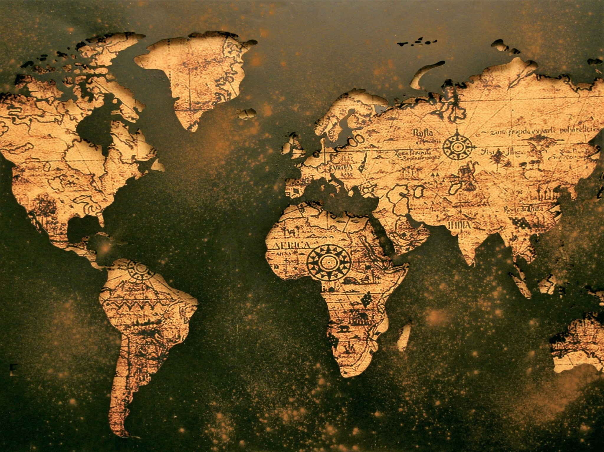 Old map of the world showing countries in gold.