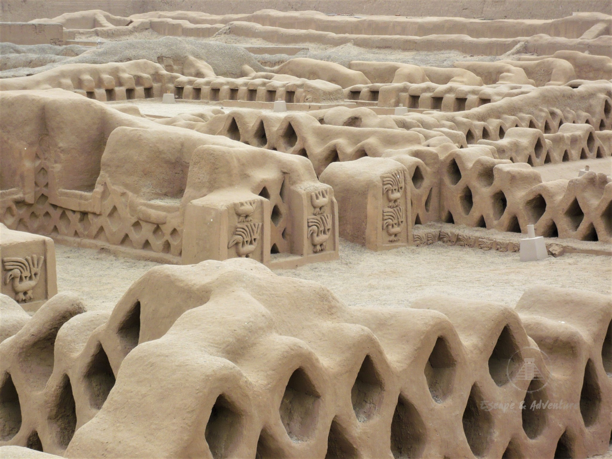 Close-up of sand-coloured ruins at Chan Chan Archaeological Zone, Peru.