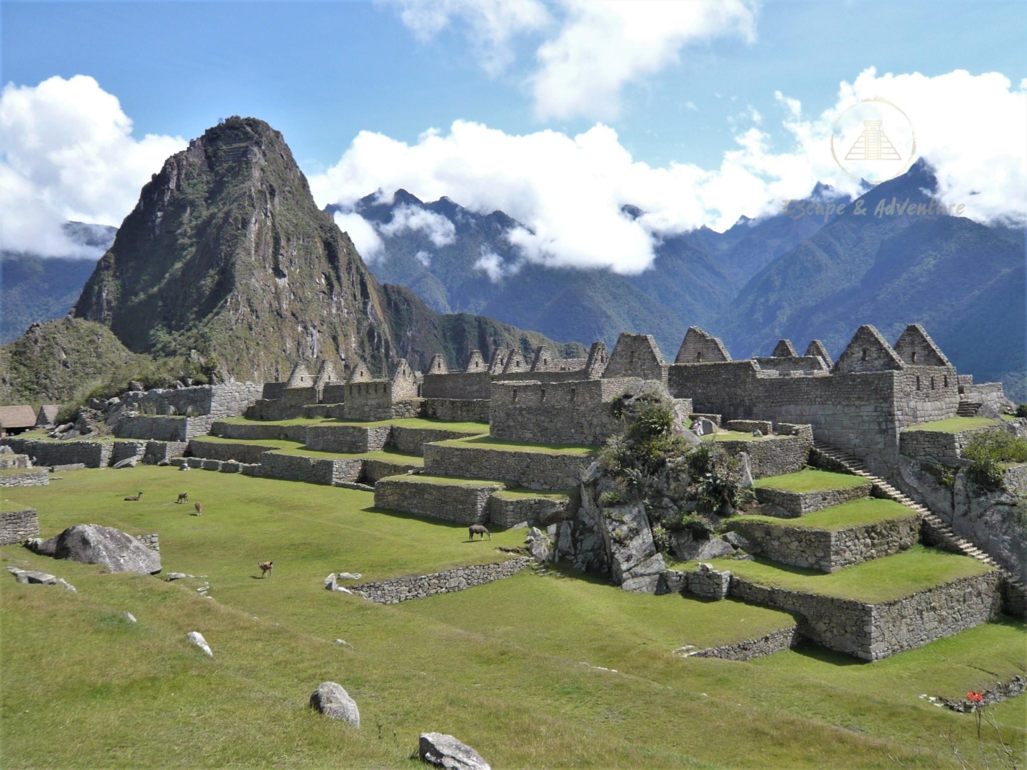Panorama of Machu Picchu archaeological site and Huayna Picchu mountain peak.