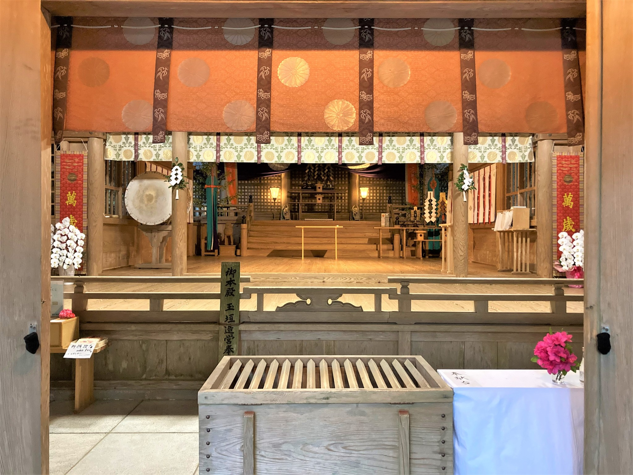 The interior of Takachiho Shrine containing Shinto religious objects and decoration.