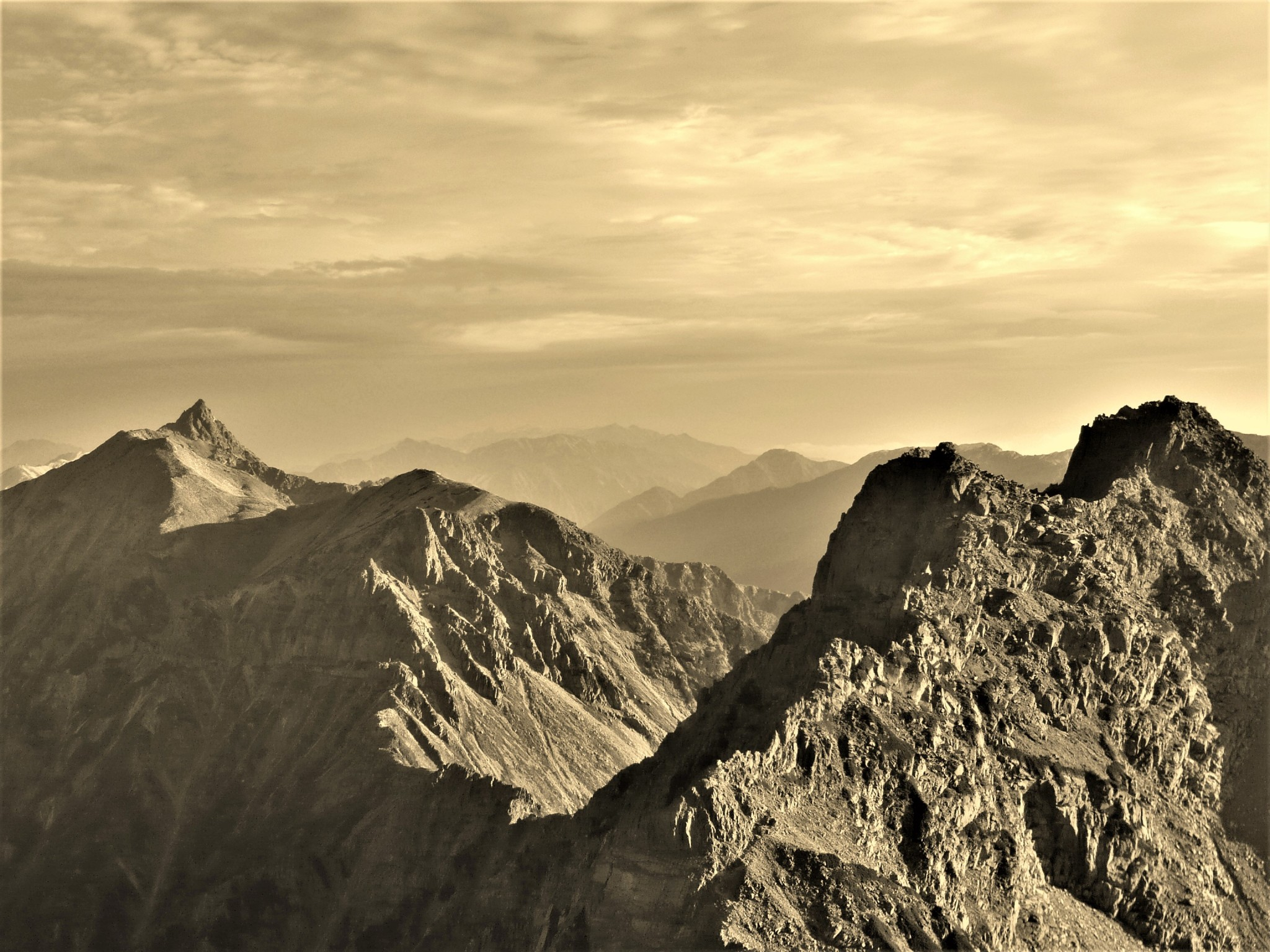 A sepia-toned panorama of Mount Yari and the Daikiretto ridgeline traverse in the Japan Alps.