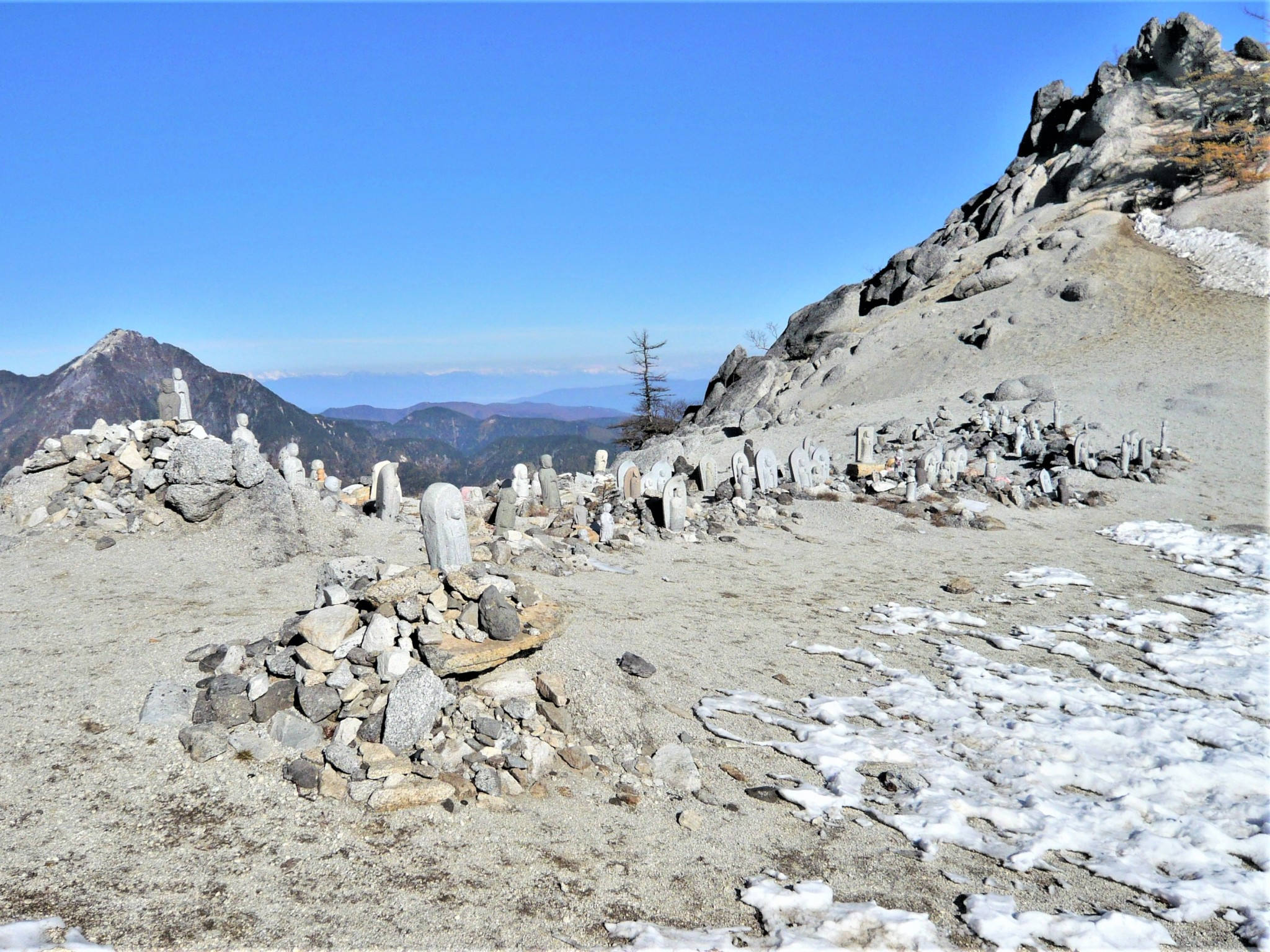 A collection of Buddhist Jizo statues at the summit of Mount Jizo in the Japan Alps.