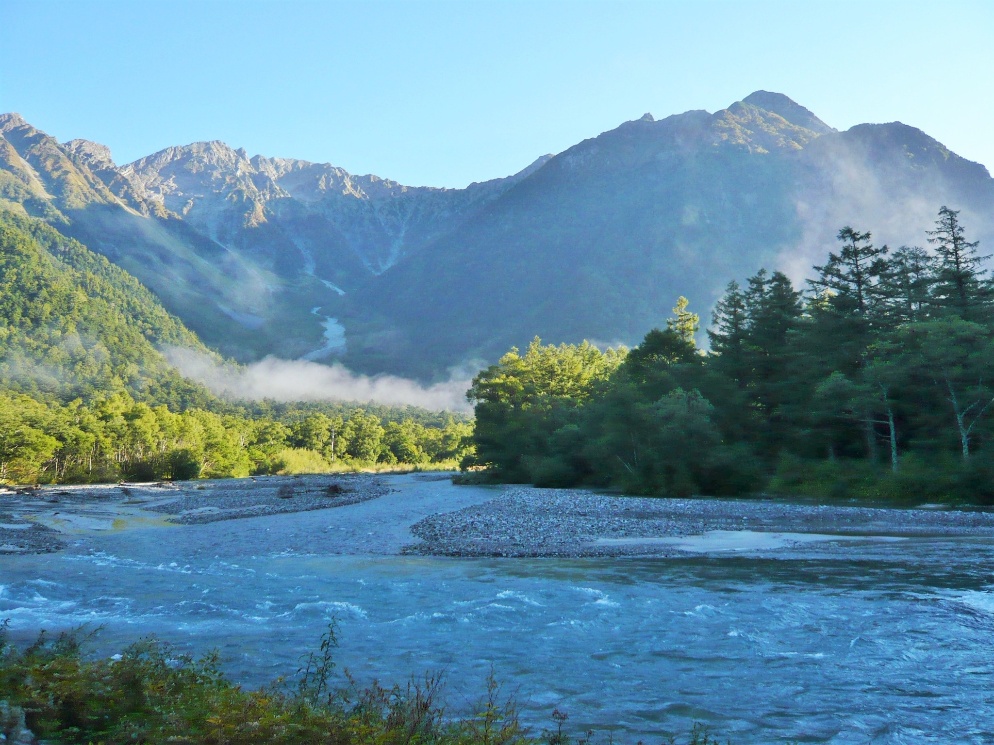 The Asuza River, Dakesawa trail, and mountains of the Japan Alps in the early morning light.