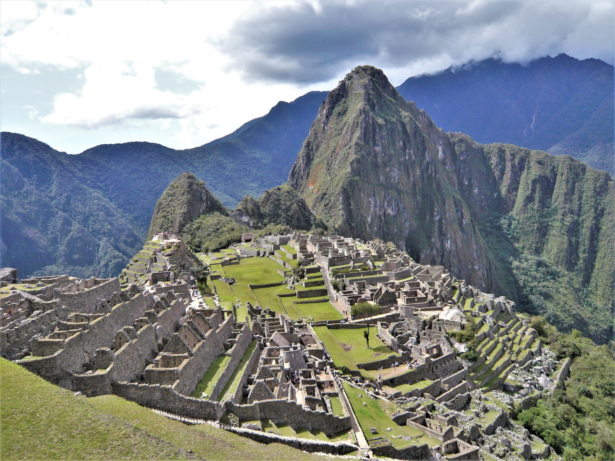 The ruins of the Incan archaeological site of Machu Picchu and surrounding mountains.