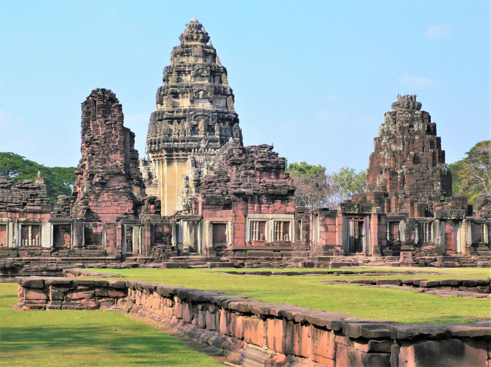 The ruins of an ancient temple and its grass-covered grounds at Phimai in Thailand.